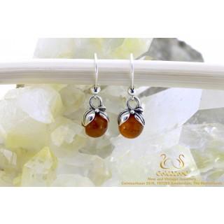 Orange barnsteen zilveren oorbellen 8mm