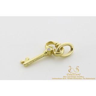 Tiffany & Co 18 karat Mini Diamond Key Charm Pendant 16 x 9 mm